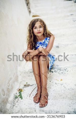 Young and beautiful, fashion girl - Santorini, Greece - stock photo