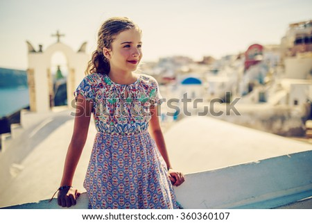 Young and beautiful girl in Oia - Santorini, Greece  - stock photo
