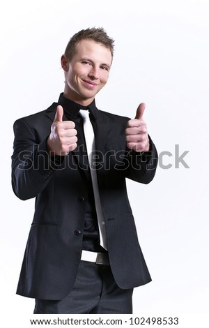 young and beautiful man making ok sign with both hands - stock photo