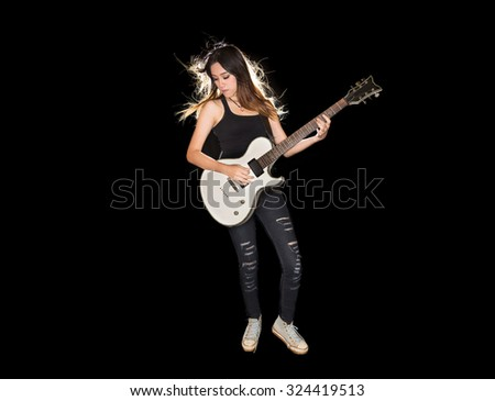 Young and beautiful rock girl playing the electric guitar - stock photo