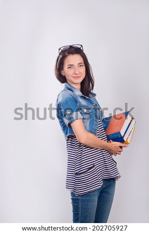 Young and beautiful student with books - stock photo