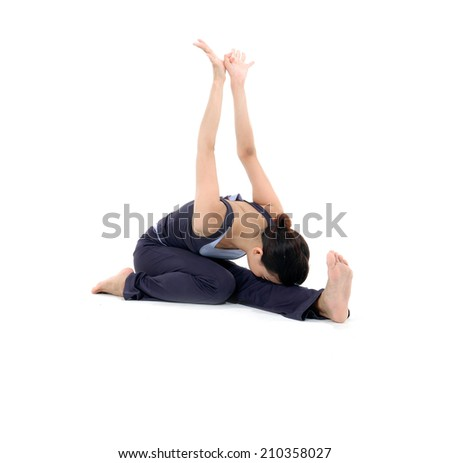 Young and beautiful woman doing yoga exercises - stock photo