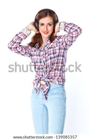 young and beautiful woman listening to music on headphones - stock photo
