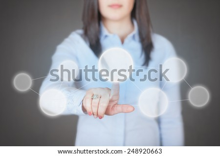 Young and beautiful woman pressing high tech (modern) button touch interface (virtual) - with place for logo, text or product - stock photo