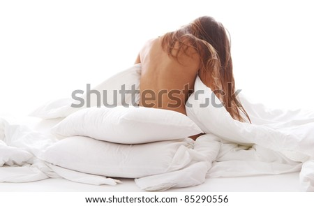 Young and beautiful woman relaxing in bed at morning - stock photo