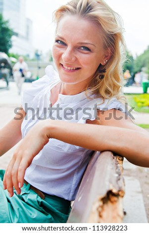 Young and beautiful woman relaxing in the park - stock photo