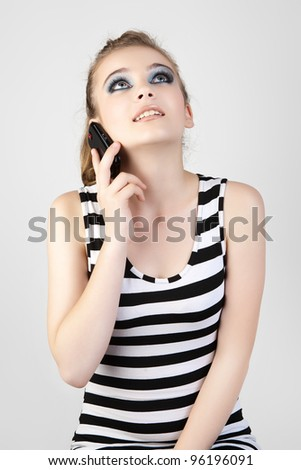 Young and beautiful woman talking on the mobile phone. - stock photo