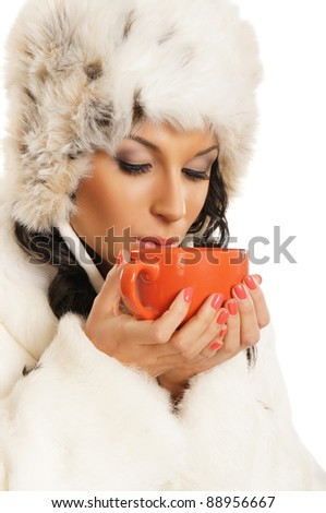 Young and beautiful woman with a red cup isolated on white - stock photo