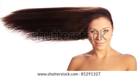 Young and beautiful woman with long hairs against white background - stock photo