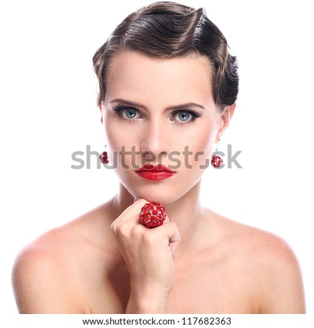 Young and beautiful woman with red jewelry over white background looking - stock photo