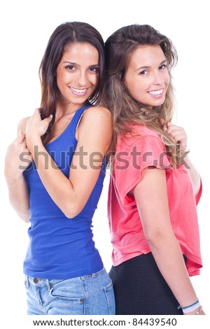 young and beautiful women standing, smiling and posing - stock photo