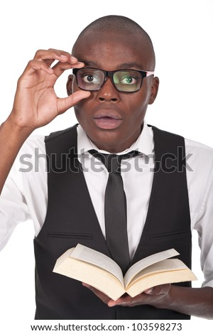 young and black holding a book and looking serious - stock photo