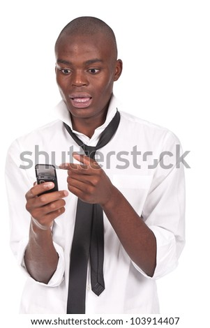 young and black man holding a cellphone and looking surprised - stock photo