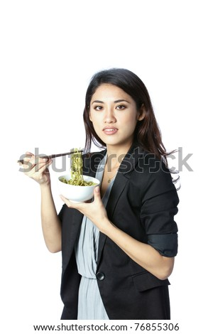 young and confident asian businesswoman eating noodles - stock photo