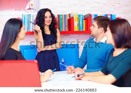 young and creative team discussing business project - stock photo