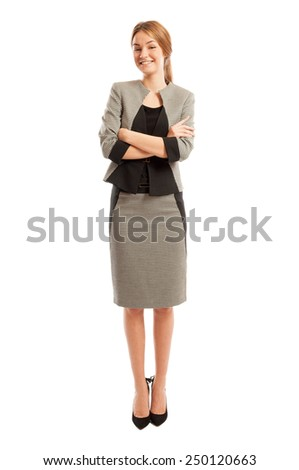 Young and elegant business woman standing with confidence on white studio background - stock photo