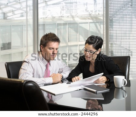 Young and good-looking business people are working in the meeting room. - stock photo