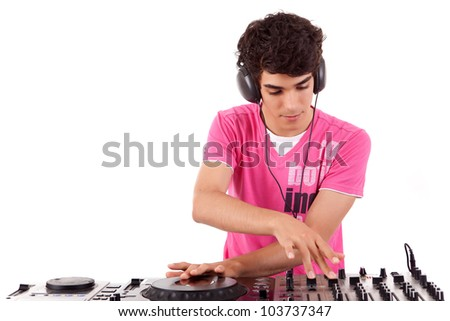 Young and handsome dj playing some music - stock photo
