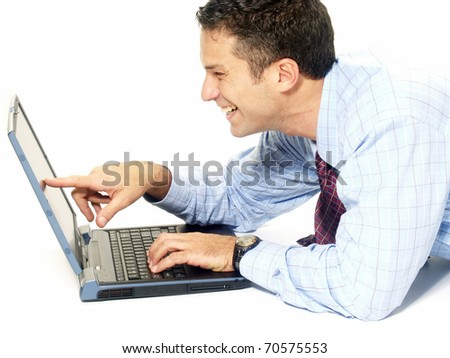 Young and happy businessman working with a laptop on white background. - stock photo