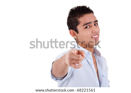 young and happy latin man pointing, isolated on a white background, studio shot - stock photo