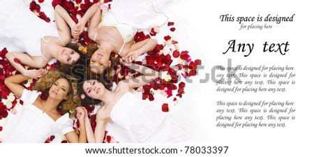 Young and healthy girls over white silk and rose petals - stock photo