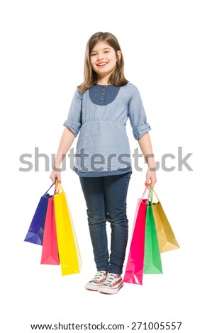 Young and joyful shopping girl with shopping bags on white background - stock photo