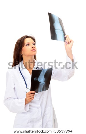 young and nice doctor watching a patient x-ray in hospital - stock photo