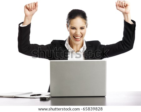 Young and pretty Businesswoman excited looking at laptop - stock photo