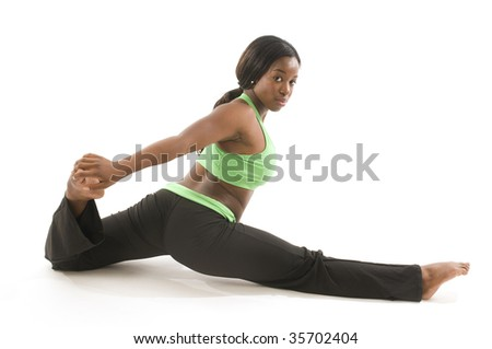 young and pretty hispanic latina black woman wearing exercise tights and working out with dance ballet movements - stock photo