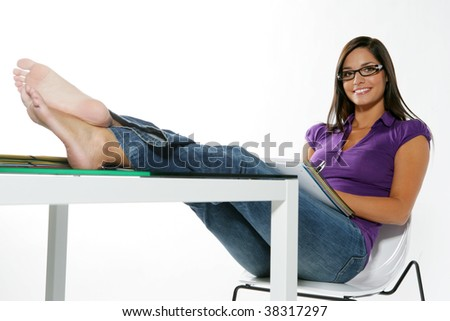 Young and pretty student in purple - stock photo