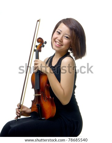 Young and pretty teenager girl smiles with violin, isolated background - stock photo