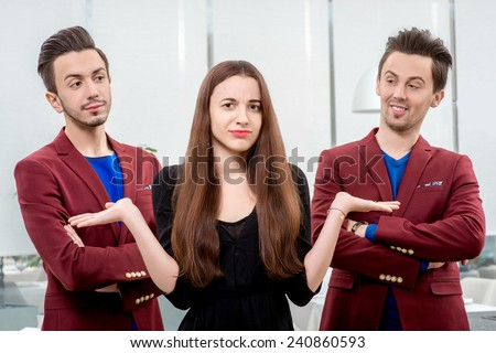 Young and prety woman choosing boyfriend from two similar brothers - stock photo