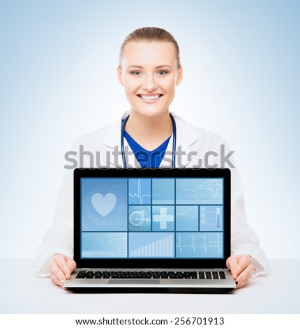 Young and professional medical doctor showing a laptop pc. Tile design and technology concept.  - stock photo