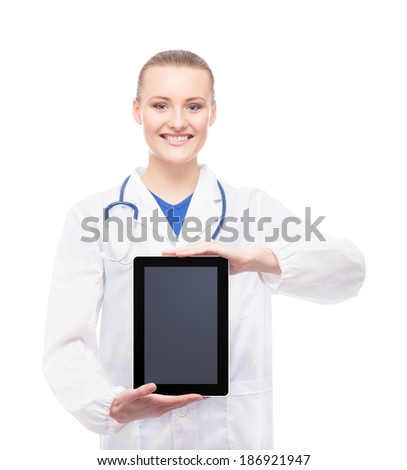 Young and professional woman doctor with an ipad isolated on white - stock photo