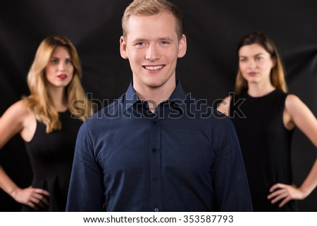 Young and rich man is desirable for women - stock photo