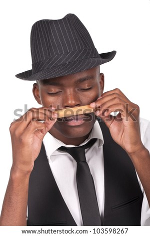 young and sexy black man wearing a hat and smelling a cigar - stock photo