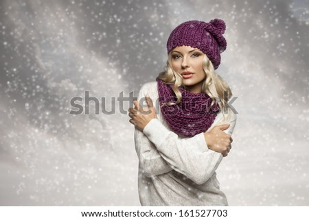 young and sexy blond girl wearing purple scarf and hat in winter dress over white - stock photo