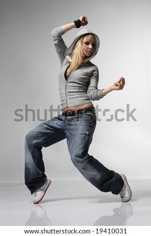 young and stylish dancer posing on grey - stock photo