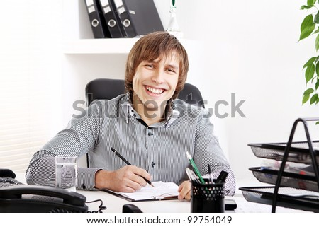 Young and successful businessman in his office - stock photo
