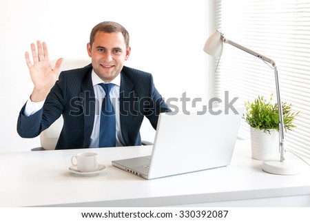 Young and successful businessman typing on his laptop - stock photo