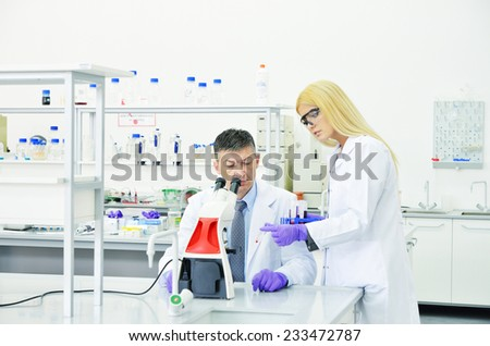 young and successful scientist researcher in the laboratory of the University - stock photo