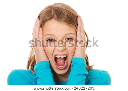 Young angry teenager screaming loud - stock photo