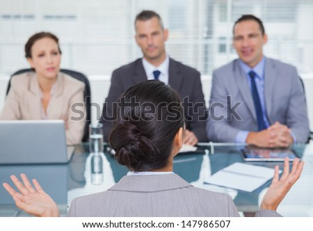 Young applicant having an interview in bright office - stock photo