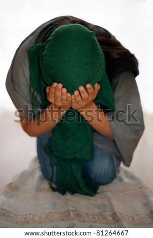Young Arab Girl Praying - stock photo