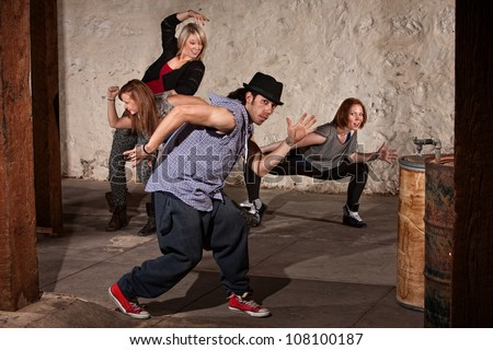 Young Arab hip hop dancer posing with crew - stock photo