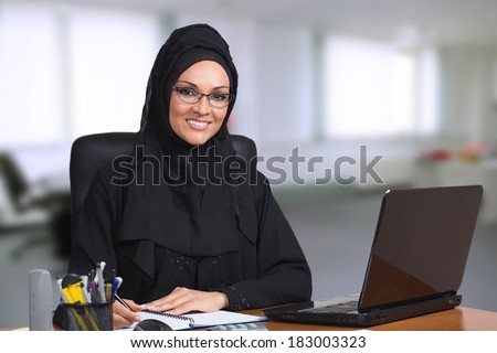Young Arabic business woman,working in her office. - stock photo