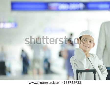 Young Arabic kids passengers traveling at the airport - stock photo
