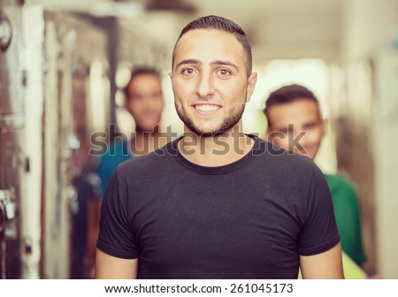 Young Arabic people in locker room at university - stock photo