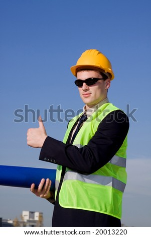 young architect in front of industrial construction site - stock photo