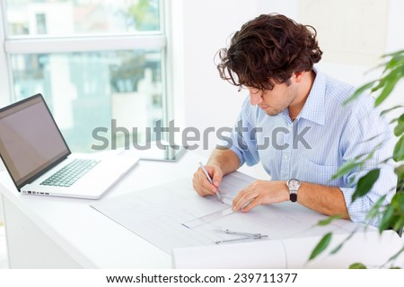 Young architects working at office - stock photo